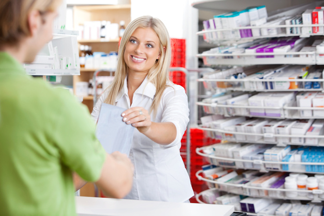 Female pharmacist with a customer in her pharmacy