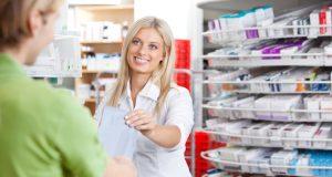 Female pharmacist with a customer in her pharmacy