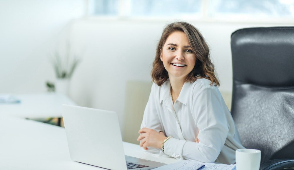 Young woman in office working